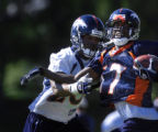 (DOVE VALLEY, Co., SHOT 7/29/2004) Rookie wide receiver Darius Watts (#17) tries to break away...