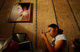 (AURORA, CO., JULY 28, 2004) Ariunaa Jargalsaikhan, 17, does her make-up in one of the two women's...