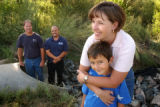 (Thornton, Colo., July 29, 2004) Kathy Worthington, top right, holds her son, Tony Salazar, 8,...