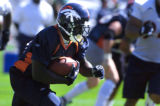 (DOVE VALLEY, Co., SHOT 7/29/2004) Denver Broncos' running back Garrison Hearst (#20) rushes with...