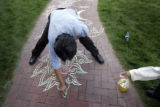 On September 15, 2006, a Tibetan artist named Gyatso (cq) from Boulder, decorates a walkway for...