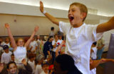 (Glendale, Colo., July 15, 2004) White team member Joe Kezminsky, 10, of Littleton, cheers while...