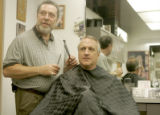 Gubernatorial candidate Bill Ritter gets his hair cut by Thomas Simone (CQ) at the Cutting...