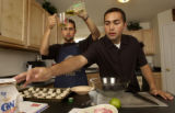 (WESTMINSTER, Colo., July 15, 2004)  Joseph, left, and Jonathan Garcia, (fraternal twins), 18,...