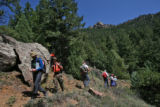 Members of a group of marines, two, fare left,  search the  mountains in Eldorado Canyon State...