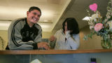 Rick Ramirez, (cq) 22 and fiancee' Majesta Montez (cq) 22 both from Denver, joke with the clerk as...