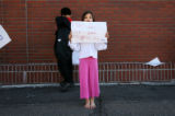 Aisha Haroon, cq, 6, holds one of the signs she and her three siblings had made as a plea for her...