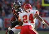 (JPM0548) Denver Broncos receiver Javon Walker, #84, turns toward Kansas City Chiefs cornerback Ty...