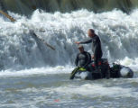 Mesa County Search & Rescue Dive team searches the bottom edge  of the Gunnison River roller...