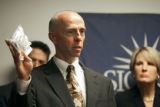 DEA Special Agent in Charge for the Rocky Mountain Region Jeffrey Sweetin (CQ, center) holds a...