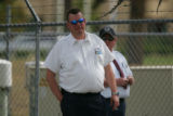 Two Federal Bureau of Prisons employees who subdued a gunman stand at the scene where a plain...