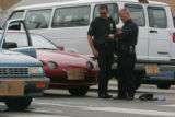 Aurora Police Officers investigate the scene of a shooting at the corner of Peoria and Montview on...