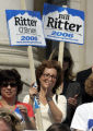 Rebecca Gershten (cq) a rape victim of Brent Brents,  cheers during a rally for  Bill Ritter ...