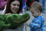 DLM04117   Lori Hayhurst, 33, of Denver, shows off her stuffed crocidile to one-year-old Jonah...