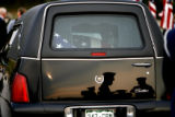 DLM00274   The color guard is reflected in the back of the  hearse carrying the remains of Maj....