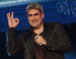 "JPM417 Taylor Hicks flashes an ""OK"" sign to fans as he performs during an encore at the..."
