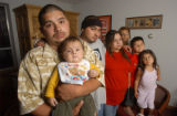 [(Denver, colo.,Shot on: 7/17/04)] Frank Lobato's family (from left) Frank Lobato Jr, 25,  holds...