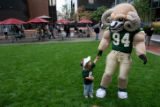 DLM00816   Two-year-old Ridley Clark of Centennial holds hands with Colorado State University...