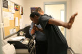 Adams County Sheriff's deputy, Leroy Olivas, administers a breathalyzer test to Jerry Colquitt,...