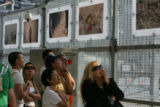 9/11 story.   Crowds visit the site of the ground zero in Manhattan, New York at dusk on Sept 7,...