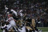 JPM022 Denver Broncos runningback Mike Bell leaps over the goal line in the closing moments of the...