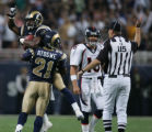 JPM223St. Louis Rams cornerback Fakhir Brown, #34, is hoisted by Rams safety Oshiomogho Atogwe,...