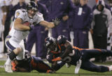 Baltimore Ravens Todd Heap is tackeld by Denver Broncos Sam Brandon and Al Wilson, right, in the...