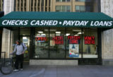 A customer leaves Cash Payday Express on Stout Street in Downtown Denver on Monday, September 25,...