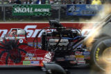 (Morrison, Colorado. July18, 2004) Scott Kalitta jumps off the start line during his winning run...