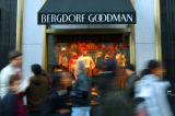 397686 04: Shoppers file past the Bergdorf Goodman store on Fifth Avenue November 24, 2001 in New...