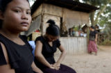 Kampong Chnang Province, Cambodia.  November 4, 2003.  Prostitutes in front of their brothel: ...