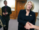 U.S. Representative Marilyn Musgrave shakes hands after she presented a ceremonial check for...