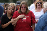 Parents wait for news during a hostage situation at Platte Valley high school in Bailey on...