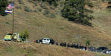A line of SWAT Team members leave Platte Canyon HIgh School Wednesday after a hostage standoff at...