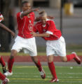 East High School players Sulaiman Shareef , left, and Zack Bolden, right, celebrate East's second...