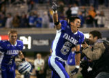 The Air Force Falcons' Chris Sutton (#6, CB) rushes towards the cadet section with teammate Chad...