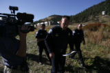 DLM00551   Park County Sheriff Fred Wegener makes his way to a 4:00 p.m. press conference where he...