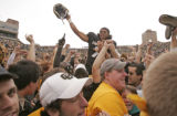 Colorado Buffaloes quarterback Bernard Jackson is lifted in the air by students after the Buffs...