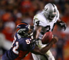 Ian Gold forces LaMont Jordan to fumble the ball in the fourth quarter of the Denver Broncos...