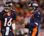Jake Plummer and Jason Elam celebrate as they watch Elam's 51-yard kick go through the uprights in...