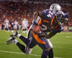 The Denver Broncos' Champ Bailey (#24, CB) intercepts a long pass intended the Oakland Raiders'...