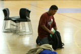 Former Manual student, Ricky Escobeda, 17, loads his backpack on the gym floor of his former...