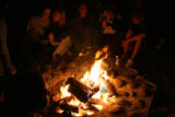 DLM02045   Bailey teens gather around the campfire to roast marshmallows during a healing service...