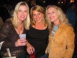 From left, Amy Natvig, Shannon Huehn and Tamara Dougherty enjoy the auction action benefiting...