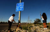 (THORNTON, CO. JUNE 21, 2004)  Renee Gonzales, and daughter Marissa Gonzales, 8, left flowers at...