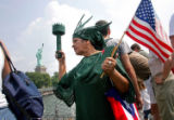 NYT16 - (NYT16) NEW YORK -- August 3, 2004 -- STATUE-OF-LIBERTY -- Luz Pagan, 62, wearing a Miss...