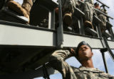 MJM053 Private first class, Kevin Lynum (cq)of the Army 2nd Brigade listens to speakers during a...