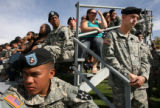 MJM140  Members of the Army 2nd Brigade listen to speakers during a departure ceremony Monday...