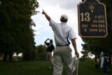 2005 5A Boys State Golf champions Steve Ziegler, cq, of Legacy High School, points out the...