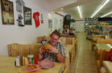 Russ Gardner at Rulon's Burger Barn in Afton. He's holding the Rulon Burger, a 1.5 pound burger...
